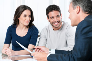 financial advisor counseling a young couple