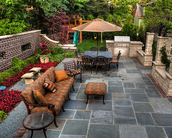 backyard patio, with built-in gas grill and adjacent swing set