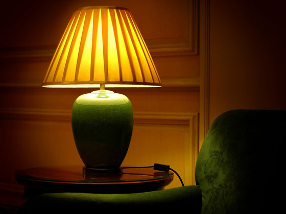 end table, table lamp, and sofa