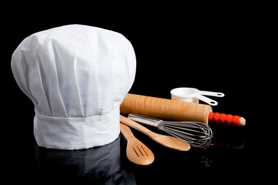 chef's toque blanche and cooking utensils